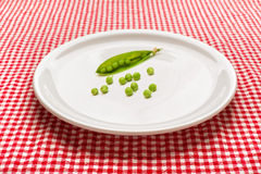 Raw peas on plate Royalty Free Stock Image
