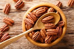Raw pecan nuts in a bowl close-up. horizontal top view. Raw pecan nuts in a bowl close-up on the table. horizontal top view from above royalty free stock images