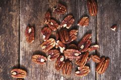 Raw Pecans on Aged Wood. Raw Organic Pecans on Aged Wood Closeup Stock Image