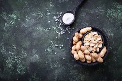 Raw peeled peanuts on bowl. Top view Royalty Free Stock Photos