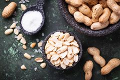 Raw peeled peanuts on bowl. Top view Royalty Free Stock Photography