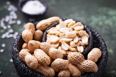 Raw peeled peanuts on bowl. Selective focus Stock Photo