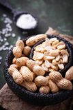 Raw peeled peanuts on bowl. Selective focus Royalty Free Stock Photography