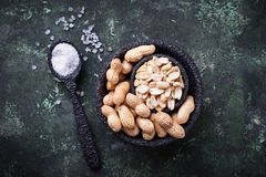 Raw peeled peanuts on bowl. Top view Stock Photo