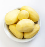 Raw peeled potatoes Royalty Free Stock Images