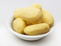 Raw peeled potatoes isolated Stock Images