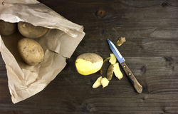 Raw and Peeled Potatoes Stock Photos