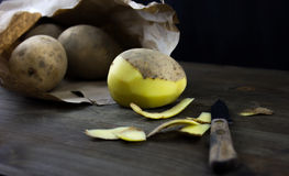 Raw and Peeled Potatoes Royalty Free Stock Photo