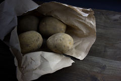 Raw and Peeled Potatoes Stock Images