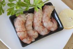 Raw peeled prawns with parsley Stock Photo