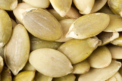 Raw peeled pumpkin seeds close up background Royalty Free Stock Photo
