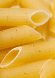 Raw penne pasta close up. Studio shot Royalty Free Stock Images
