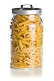 Raw penne pasta in glass jar Royalty Free Stock Photo