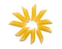 Raw penne pasta sun Stock Photo