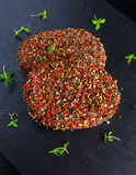 Raw peppered ground beef meat cutlets for burgers Stock Image