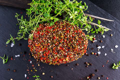 Raw peppered ground beef meat cutlets for burgers Royalty Free Stock Photos