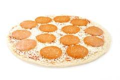 Raw pepperoni pizza Stock Photos