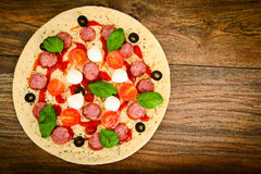 Raw Pepperoni Pizza with Sausage, Cheese, Mozzarella, Olives and Royalty Free Stock Photography