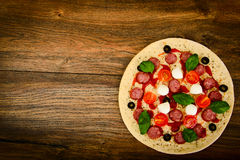 Raw Pepperoni Pizza with Sausage, Cheese, Mozzarella, Olives and Royalty Free Stock Image