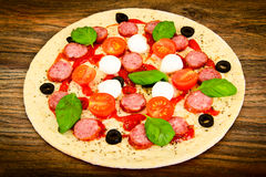 Raw Pepperoni Pizza with Sausage, Cheese, Mozzarella, Olives and Stock Photos