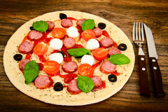 Raw Pepperoni Pizza with Sausage, Cheese, Mozzarella, Olives and Stock Images