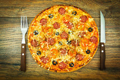 Raw Pepperoni Pizza with Sausage, Cheese, Mozzarella, Olives and Stock Image