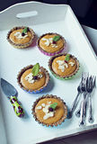 Raw persimmom squash pies. In white wooden tray Royalty Free Stock Photography