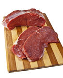 Raw piece of beef. Raw beef on cutting board isolated on white background Stock Photos
