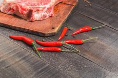 A raw piece of beef with peppers stock photo
