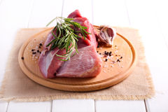 Raw piece of beef and rosemary Royalty Free Stock Photo