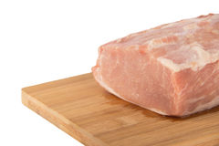 Raw piece of meat on a wooden board on a white background. Large raw piece of meat on a wooden board on a white background Stock Images
