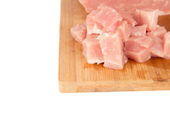 Raw piece of meat on a wooden board on a white background. Large raw piece of meat on a wooden board on a white background Stock Image