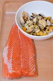 Raw piece of a salmon and raw peeled oysters ready to preparation Royalty Free Stock Photography