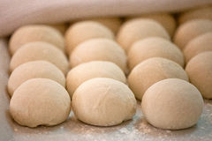 Raw pieces of bread dough before fermentation and baking. Process royalty free stock photography
