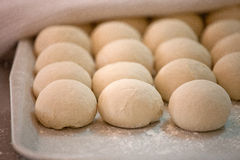 Raw pieces of bread dough before fermentation and baking. Process royalty free stock photo