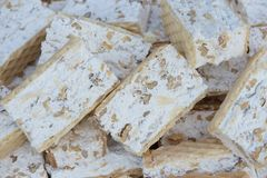 Raw pieces of nougat with nuts. Stock Images