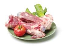 Raw pig bone. Isolated on white background stock image
