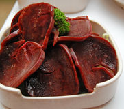 Raw Pig Liver. A plate of raw pig's liver for steamboat dining Stock Photography