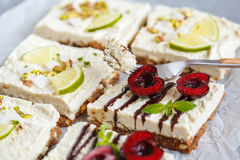 Raw pistachio, coconut, lime and chocolate-cherry cheesecakes. Royalty Free Stock Photo