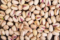 Raw pistachio nuts. Heap texture background stock photos