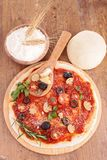 Raw pizza dough and ingredient. On wood Stock Photography