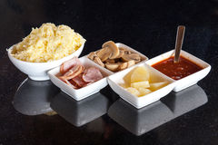 Raw pizza ingredients. Sauce, cheese, mushrooms, beef and pineapple Royalty Free Stock Images