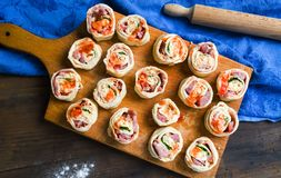 Raw pIzza rolls pastry on a wooden board stock images