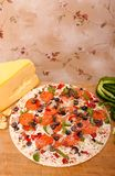 Raw pizza with vegetables and pepperoni Royalty Free Stock Photos