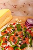 Raw pizza with vegetables and pepperoni Royalty Free Stock Images