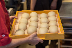 Raw plain buns in a bakery. Some raw plain buns in a bakery stock photography