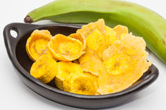 Raw plantain cups, patacones and pieces Stock Photo