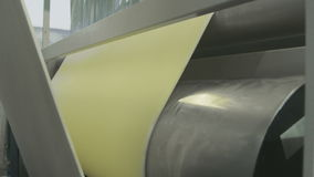 Raw plastic sheet extrusion line. Roll close up stock footage