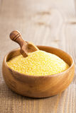 Raw polenta in a wooden bowl Royalty Free Stock Photography