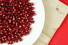 Raw Pomegranate Seeds. On White Plate. Fresh Fruits Photo Collection Royalty Free Stock Photos